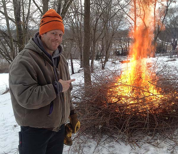 Burning a pile of invasive buckthorn.