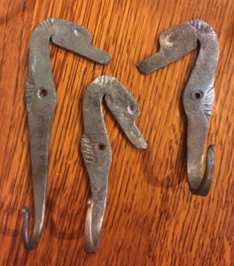 Custom blacksmith work. Seahorse hooks.