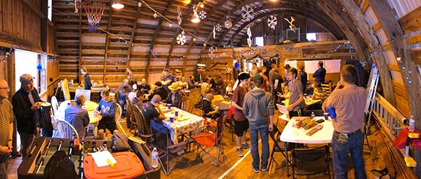 Barn full of people playing games of cribbage.